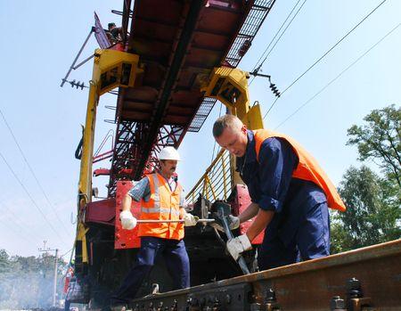 KYIV REGION, UKRAINE - AUGUST 21: Repair workers modernize the 1, 000th km of Irpin-Bucha railway line on August 21, 2007  in Kyiv region, Ukraine Stock Photo - 6888811