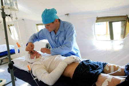 VINNYTSYA, UKRAINE - JUNE 10, 2008: surgeons in operative room in military mobile hospital during a medical military trainings  on June 10, 2008 in Vinnytsya, Ukraine Stock Photo - 6888816