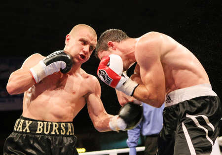 KYIV, UKRAINE - JUNE 14: Ukrainian Maxim Bursak (R) fights with his Italian opponent Giovanni de Carolisa during the boxing tournament on June 14, 2008 in Kyiv, Ukraine