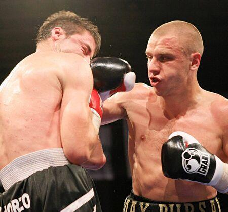 KYIV, UKRAINE - JUNE 14: Ukrainian Maxim Bursak (R) fights with his Italian opponent Giovanni de Carolisa during the boxing tournament on June 14, 2008 in Kyiv, Ukraine