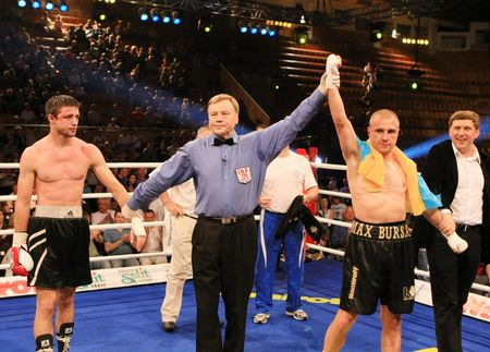 KYIV, UKRAINE - JUNE 14: Ukrainian Maxim Bursak (R) and his Italian opponent Giovanni de Carolisa after the boxing tournament on June 14, 2008 in Kyiv, Ukraine Editöryel