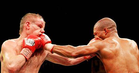 combative:  KIEV, UKRAINE - APRIL 19: WBA welterweight belt holder Yuriy Nuzhnenko throws a punch against Irving Garcia during their WBA World Welterweight Title fight on April 19, 2008 in Kyiv, Ukraine