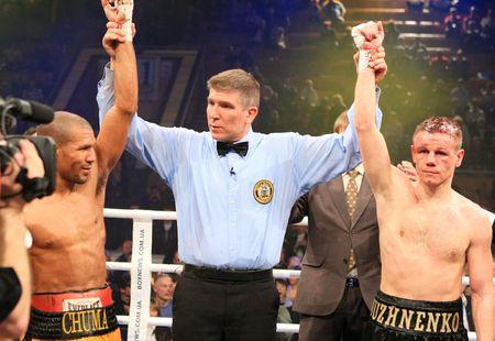 KIEV, UKRAINE - APRIL 19: WBA welterweight belt holder Yuriy Nuzhnenko  against Irving Garcia during their WBA World Welterweight Title fight on April 19, 2008 in Kyiv, Ukraine