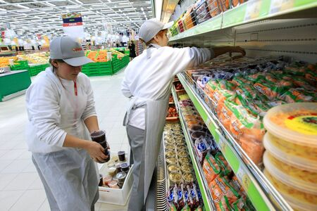 KYIV, UKRAINE - NOVEMBER 13: Worker in supermarket during prepare to opening first store of OK supermarket network on November 13, 2007 in Kyiv, Ukraine.