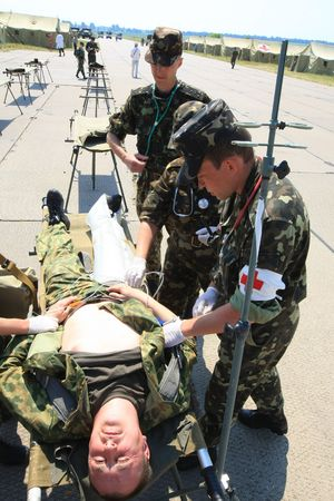 VINNYTSYA, UKRAINE - JUNE 10, 2008: surgeons in military mobile hospital during a medical military trainings on June 10, 2008 in Vinnytsya, Ukraine