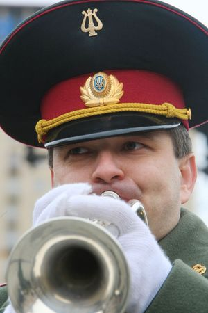KYIV, UKRAINEA  - FEB 23: military musician plays during the orchestra parade dedicated to the Motherland Defender Day celebrations on  Independence Square February on 23, 2008 in Kyiv, Ukraine