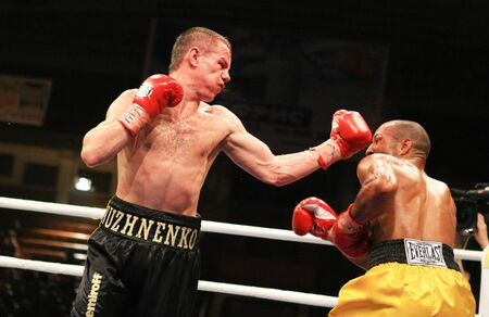 boxing knockout: KIEV, UKRAINE - APRIL 19: WBA welterweight belt holder Yuriy Nuzhnenko throws a punch against Irving Garcia during their WBA World Welterweight Title fight on April 19, 2008 in Kyiv, Ukraine Editorial