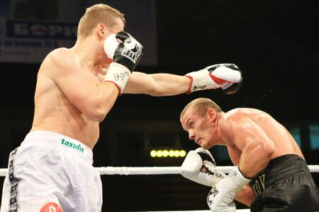 wba: KIEV, UKRAINE - JUNE 19,: Vyacheslav Uzelkov (R) fights with Berlin-based Slovenian Denis Simcic for the WBA Intercontinental light heavyweight champion belt on June 19, 2008 in Kiev, Ukraine