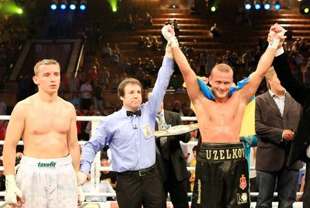 KIEV, UKRAINE - JUNE 19,: Vyacheslav Uzelkov (R) fights with Berlin-based Slovenian Denis Simcic for the WBA Intercontinental light heavyweight champion belt on June 19, 2008 in Kiev, Ukraine