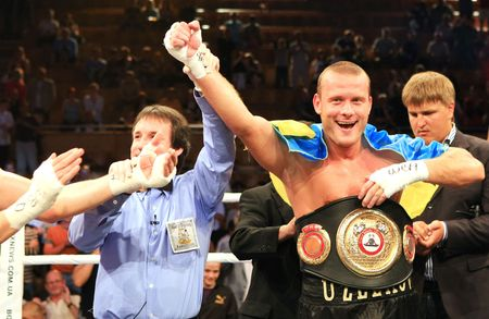 KIEV, UKRAINE - JUNE 19,: Vyacheslav Uzelkov (R) fights with Berlin-based Slovenian Denis Simcic for the WBA Intercontinental light heavyweight champion belt on June 19, 2008 in Kiev, Ukraine