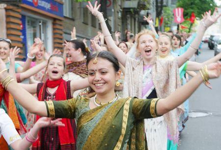 krishna: KYIV, UKRAINE - MAY 04: Devotees from Hare Krishna dancing with carnival revelers on Kiev street on May 04, 2008 in Kyiv, Ukraine