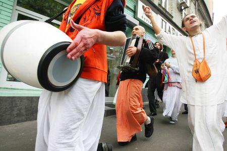 kyiv: KYIV, UKRAINE - MAY 04: Devotees from Hare Krishna dancing with carnival revelers on Kiev street on May 04, 2008 in Kyiv, Ukraine
