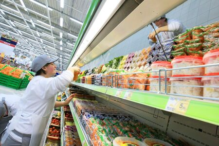 KYIV, UKRAINE - NOVEMBER 13: Worker in supermarket during preparation for the opening of the first store of OK supermarket network on November 13, 2007 in Kyiv, Ukraine. Stock Photo - 6889996