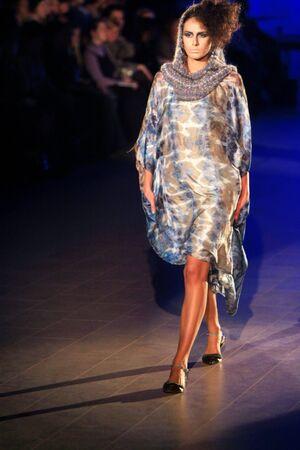 KYIV, UKRAINE - MARCH 15: A model walks the runway wearing an outfit by Oksana Karavanska of her Fall Winter 0809 collection during the 22nd Ukrainian Fashion Week on March 15, 2008 in Kyiv, Ukraine