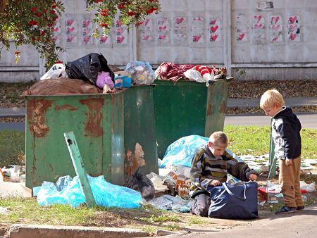 KIEV, UKRAINE - OCTOBER 6: Homeless children at a  dump on October 6, 2006 in Kyiv, Ukraine