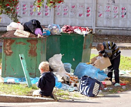 KIEV, UKRAINE - OCTOBER 6: Homeless children at a  dump on October 6, 2006 in Kyiv, Ukraine