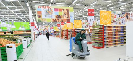 supermarket shelves: KYIV, UKRAINE - NOVEMBER 13: Worker in supermarket during preparation for the opening of the first store of OK supermarket network on November 13, 2007 in Kyiv, Ukraine.
