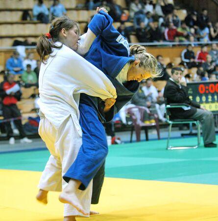 female fighter: KYIV, UKRAINE - MAY 13: International tournament category A of the European Judo Union among juniors  Typhoon on tatami on May 13, 2007 in Kyiv, Ukraine