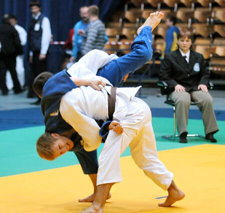 self defence: KYIV, UKRAINE - MAY 13: International tournament category A of the European Judo Union among juniors  Typhoon on tatami on May 13, 2007 in Kyiv, Ukraine