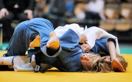 arbitrator: KYIV, UKRAINE - MAY 13: International tournament category A of the European Judo Union among juniors  Typhoon on tatami on May 13, 2007 in Kyiv, Ukraine