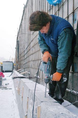 foundation problems: KYIV, UKRAINE -JANUARY 31: Worker at  construction site of Podolsko-Voskresensky bridge during open doors day on January 31, 2007 in Kyiv, Ukraine