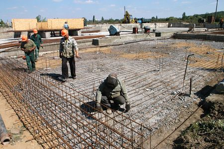 KYIV REGION, UKRAINE - SEP 3: Workers at construction site of water filtration station during open doors day on September 03, 2007 in Kyiv region, Ukraine