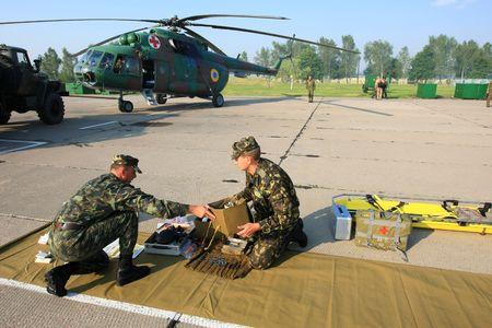 emergency lane: VINNYTSYA, UKRAINE - JUNE 10, 2008: Military mobile hospital during a medical military trainings on June 10, 2008 in Vinnytsya, Ukraine Editorial