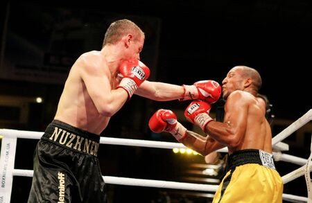 wba: KIEV, UKRAINE - APRIL 19: WBA welterweight belt holder Yuriy Nuzhnenko throws a punch against Irving Garcia during their WBA World Welterweight Title fight on April 19, 2008 in Kyiv, Ukraine Editorial