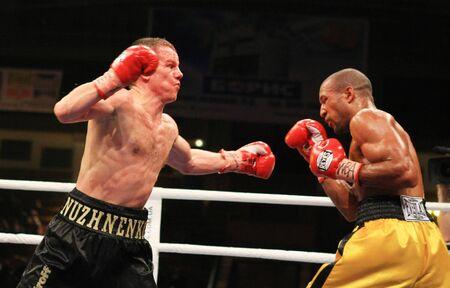 KIEV, UKRAINE - APRIL 19: WBA welterweight belt holder Yuriy Nuzhnenko(L) throws a punch against Irving Garcia during their WBA World Welterweight Title fight on April 19, 2008 in Kyiv, Ukraine