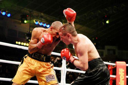 KIEV, UKRAINE - APRIL 19: WBA welterweight belt holder Yuriy Nuzhnenko(R) throws a punch against Irving Garcia during their WBA World Welterweight Title fight on April 19, 2008 in Kyiv, Ukraine