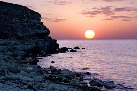 Beatifull sunset on the Crimean seashore photo