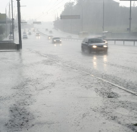 On the wet road with fast approaching cars photo