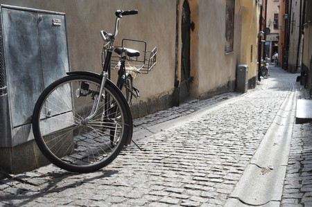 Old fashioned bicycle on old Stockholm street photo