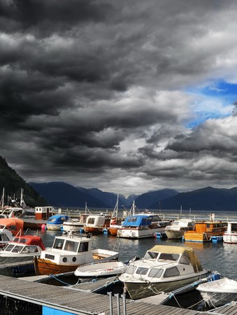 Yachts standing in marina in  Norwegian fjord  photo
