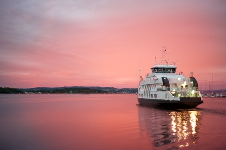 fiord: Cruise liner floating away from the Olso harbor at dawn Stock Photo