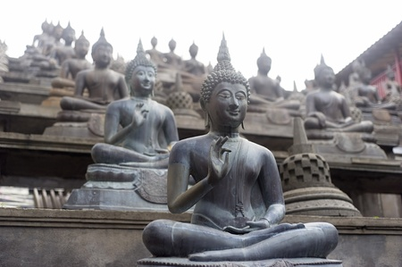 Buddhist statue in Gangaramaya Temle. Sri Lanka photo