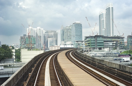 Cityscape with railway and high office buildings in Kuala Lumpur, Malaysia photo
