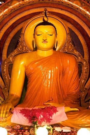 Statue of sitting Buddha a Gangaramaya temple in Colombo, Sri Lanka Stock Photo - 9581077