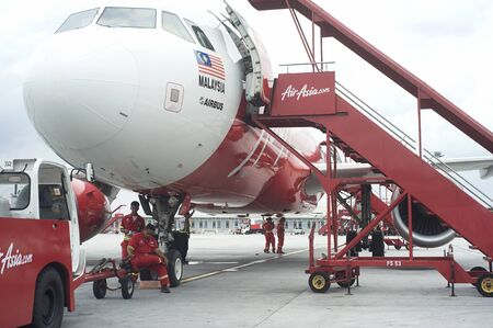 Kuala Lumpur, Malaysia - April 2, 2011: Airplane waiting for passenger at airport. Airasia is regional airline serving Malaysia and south-east asian destinations