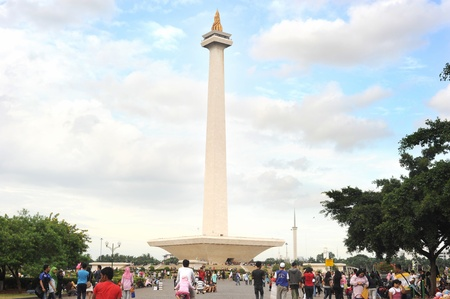 'phallic symbol': Jakarta,Indonesia - March 3, 2011: people at  National Monument l (Monas) is a 433 ft (132 meter) tower in the center of Merdeka Square, Central Jakarta, symbolizing the fight for Indonesias independence