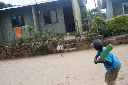 Galle, Sri Lanka -  January 27th, 2011:Srilankan boys playing cricket. Cricket is most popular game in Sri Lanka Stock Photo - 9656853