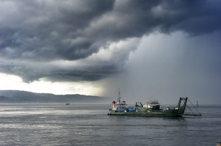 ship wreck: Ferry from Java to Bali under the storm. Indonesia Stock Photo