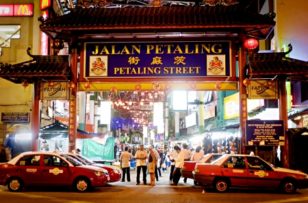 lumpur: Kuala Lumpur, Malaysia - March 30, 2011: Petaling Street or known as Chinatown among tourists is the centre of Kuala Lumpurs original Chinatown. The street is also affectionately known as PS among locals