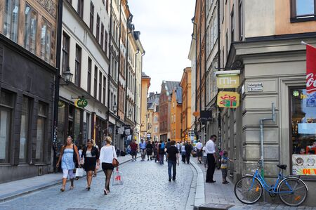 Stockholm, Sweden - August 11, 2010: Central street of Gamla Stan with many tourists. Sweden