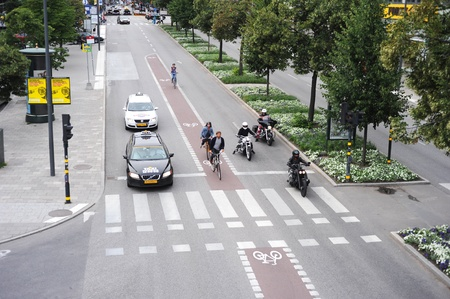 STOCKHOLM, SWEDEN - AUGUST 18, 2010: Special line for bicyles and scooters as a result of enormous amount of vehicles on the road