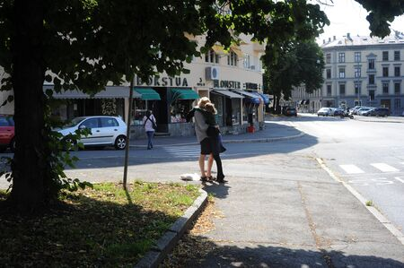 Oslo, Norway - August 15, 2010: Couple kissing on Oslo street. Norway Stock Photo - 9730206