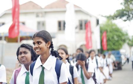 Galle, Sri Lanka - January 26, 2011: : Pupils walking on the street during 5 Annual School Festival on January 26, 2011 in Galle, Sri Lanka