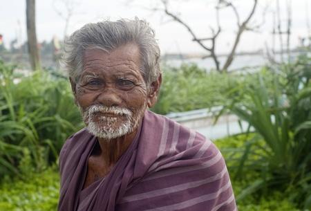 indian village: Hikkaduwa, Sri Lanka - February 2, 2011: Portrait of a poor Sri Lankan man.About 80 percent of Sri Lanka s population lives in its rural areas. The rural poor account for 95 percent of the countrys poor.  Editorial