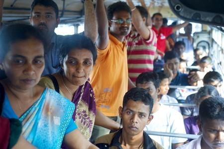 Colombo, Sri Lanka - February 22, 2011: Sri Lankan people inside public bus.