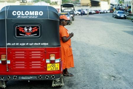 Colombo, Sri Lanka - February 22, 2011: Worker of Sri Lankan traditional taxi(tuk-tuk) waiting for clients. Stock Photo - 10434656